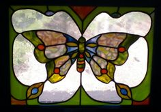 This signed, original stained glass window was inspired by a Butterfly I found…