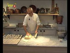 "Springerle making video, in German - Café Sommer. Even if you don't speak German--watch the video--you will be able to follow his techniques--especially the use of the springerle molds. The dough making technique is strikingly similar to the Italian method of making pasta dough. Near the end of the video, he bakes the springerle--and you can see the characteristic way they rise and how the classical ""foot"" forms on the bottom of the cookies--Ann Del Tredici"