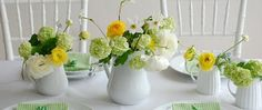 The white teapot vase add a wonderful vintage feel to this green and yellow wedding tablescape!