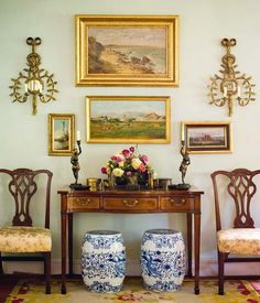 English Country foyer vignette - the chairs, the garden stools, the sconces (I die), the everything.