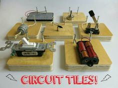 Diy modular circuit tiles using blocks of wood and screws.