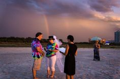 Sunset ceremony. Clearwater Beach Wedding Ceremony. Rainbow shirts, and rainbow in the sky. Simple beach ceremony. Florida notary wedding officiant. Clearwater Wedding officiant. Tallahassee Wedding officiant