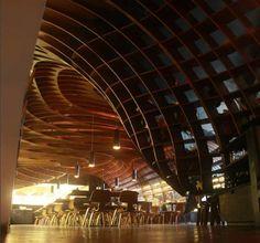 SP+A, Sameep padora and Associates, Mumbai, India, undulating ceiling, quasi-dome, dome, plywood, copper lighting fixtures, undulating geometry, parametric design