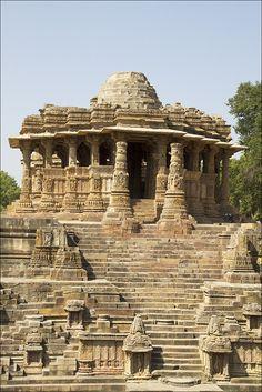 De Sun Temple Modhera, at Modhera in Gujarat_ West India, is a temple dedicated to de Hindu Sun-God, Surya. It was built in 1026 AD by King Bhimdev of de Solanki dynasty. De temple comprises three separate, axially aligned n integrated elements: Surya Kund, Sabha Mandap n Guda Mandap.