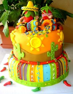 A fantastic cake for a fiestaI Love the little chili peppers and the piñata toppers.  Cute for Cinco de Mayo.