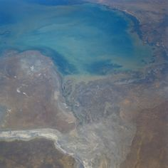 https://flic.kr/p/g7FFQo | sts028-087-061 | STS028-087-061   Caspian Sea, Mertvyy Kultuk Salt Flat, Kazakhstan   August 1989 This west-looking view shows the northeast section of the Caspian Sea.  The Caspian Sea is the world's largest inland expanse of water.  The northern part of the sea visible in this view, reaches a depth of only 17 feet (5 meters).