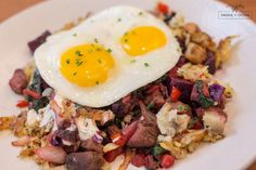 RED FLANNEL HASH W/ PRIME RIB* fingerling + red potatoes hash w/ beets, prime rib + pork roast, smoked onions, bell peppers, spinach, cabbage, red wine sauce, horseradish cream, 2 eggs + grilled sourdough bread