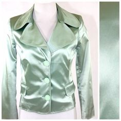 """D&G Mint Green Silky Large Button Jacket $695 38 D&G Jacket  Size 38 US 2  Retail $695   Absolutely gorgeous jacket by renown design team Dolce & Gabbana, from their D&G line.  Beautiful shade of mint green.  Very silky feeling texture. 3/4 sleeve. 51% acetate, 45% polyamide, 4% elastane.  Tags are still attached however there is a small shop wear mark on the arm.  It is barely visible and didn't show up in the photos.  Fully lined.  Bust 34""""  Shoulder to shoulder 18""""  Waist 29""""  Length of…"""