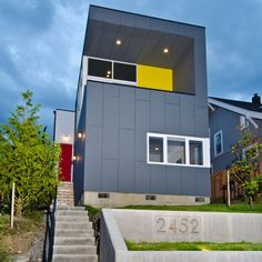 KRJZ Residence in Seattle.  Awesome job of cladding and color splash!