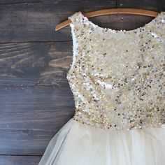 Beautiful gold sequins adorn this ballerina style tulle bottom gold dress. A darling dress for any special occasion. Perfect for prom, homecoming, birthday party, and other special events. S M L bust