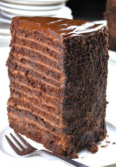 24 Layer Chocolate Cake Chocolate Cake with 12 layers of smooth chocolate filling, 12 layers of moist and rich chocolate cake, topped with a layer of semisweet chocolate ganache. Decadent Chocolate Cake, Chocolate Filling, Best Chocolate, Homemade Chocolate, Chocolate Desserts, Chocolate Ganache Cake, Vegetarian Chocolate, Savoury Cake, Desert Recipes