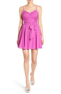 Adoring this bright magenta skater dress with a lace bodice and swingy pleated skirt for a flirty look.