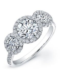 3 stone halo ring & all it needs is a black diamond center stone... my dream ring!