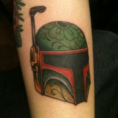 This is my own Boba Fett tattoo, day of the dead style. I love Star Wars. :D <3