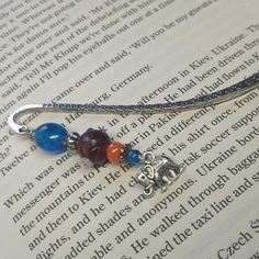 Never forget your page again with this beautiful Elephant Bookmark, lovingly handmade in Northern Ireland with silver-tone, glass and ceramic beads complimenting a Tibetan style marker. The elephant is said to be a symbol of good luck, it is also said that elephants never forget, This bookmark Elephants Never Forget, Never Forget You, Ceramic Beads, Good Luck, Organza Bags, Northern Ireland, My Images, Markers, Compliments