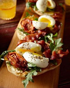 Open-face bacon and egg sandwich with arugula.