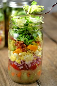 This is how you make a mason jar salad. If you pack it in this order, it will be perfect when you open the jar and dump it in a bowl.
