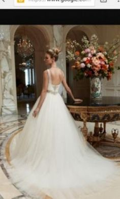 Casablanca 2091 12: buy this dress for a fraction of the salon price on PreOwnedWeddingDresses.com