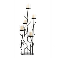 This fantastic candleholder is the perfect blend of contemporary design natural inspiration and shimmering candlelight. Five clear glass candlecups sit perched upon iron branches for a dramatic displa