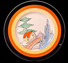 Plate in the Orange Roof Cottage pattern by Clarice Cliff Clay Design, Design Art, Clarice Cliff, Modern Art Deco, Journal Themes, Art Deco Era, Ceramic Artists, Vintage Ceramic, Beautiful Paintings