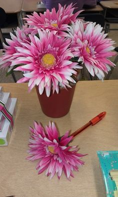 Pen Flower Pot. Take back ends off of pens. Glue a flower into the