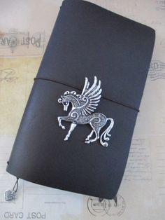 Hand crafted leather Traveler's Style refillable by bypaperflower My just purchased 1st trip into the world of Midori. Cannot wait for this baby to arrive. Love the charm.