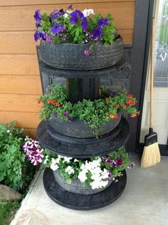 I like the idea of a planter stand made out of cable stools. I'm not fond of the tyres though.