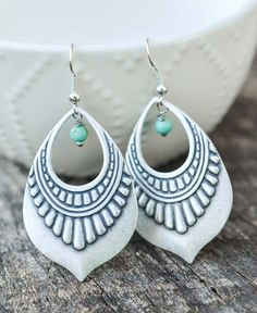 Boho Dangle Earrings - Livin' Freely   These beautiful Boho Dangle Earrings were created from 30mmx45mm tribal loop pendants adorned with turquoise bead. They are then attached to silver ear wire.