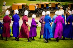 "Amish girls at an ""Amish Carriage Horse Auction"" photo source: http://behmphoto.com/amish-carriage-horse-auction/"