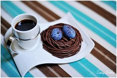 Cup of coffee and two chocolate truffle robin's eggs in a nest. Sweet!