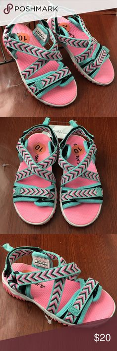 Carters Sandals Girls Pink Aqua Size 10 Toddler New with Tag!   Carter's Toddler Girls Size 10 Open Toe Sandals  Pink Aqua Black Chevron Pattern Hook and Loop Closure Non-slip / non-skid Retails $38  These sandals are great for everyday use and can be used for water activities (beach, pool, splash parks).  Thank you for stopping by. Please MAKE an OFFER or check out my Posh Closet for other items to BUNDLE and SAVE! Carter's Shoes Sandals & Flip Flops