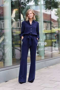 Shop this look on Lookastic: https://lookastic.com/women/looks/navy-jumpsuit-black-suede-pumps/17898   — Navy Jumpsuit  — Black Suede Pumps