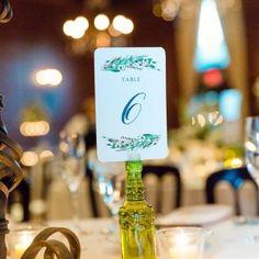 unique bottle table numbers | Leslie Ann Photography | villasiena.cc