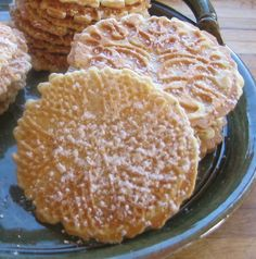 almost the same recipe i use ...Italian Pizzelles...1 1/2 cups all-purpose flour, sifted, 1 teaspoon baking powder, sifted, 3 eggs, beaten, 3/4 cup granulated sugar, 3/4 cup butter, melted and cooled to room temp, 2 teaspoons pure vanilla extract, 1 teaspoon anise oil, powdered (confectioners) sugar as sprinlke, optional...Pizzelle Variation Ideas: Lemon, Chocolate, Nut, Maple & Liqueur...