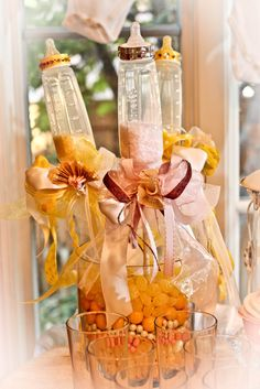 Baby Bottle Wands perfect arrangement for a baby shower.  Fill the vase with candy of your color scheme and then add the bottle wands.  T...