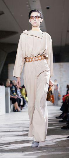 LOEWE Autumn Winter 15 look 31. Panelled layer top-nappa off silver / Skin turtle neck sweater-wool-almond /  Wide leg cargo trousers-lambskin-offwhite / Small leaf earring-silver / Small leaf earring-silver-black / Ibiza earring-silver-gold /  V shoulder bag-suede-refined calf-caramel / Empty double cube heel ankle b-ostrich-suede grey / L circle s belt calf-leather