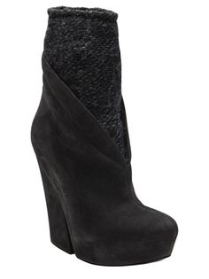 a5adabb46b2f6 Tronchetto wool sock boot in black from Vic Matie. This leather bootie  features a round