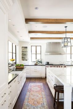Classic Spanish meets California cool in this striking kitchen makeover that transformed an outdated space into a bright, airy space for gathering.