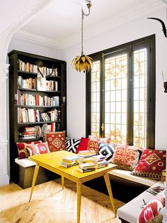 Eating/ reading nook with ethnic pillows, yellow table and built in book storage. - Daily Home Decorations Design Eclético, The Design Files, House Design, Garden Design, Home And Living, Home And Family, Family Room, Small Living, Yellow Table