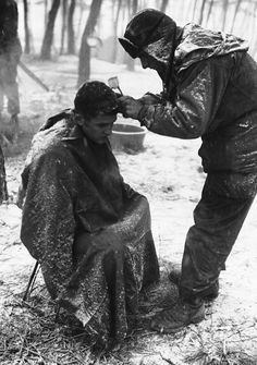"""peerintothepast:"""" No lack of fresh air in this Korean 'barbershop' near the northwestern front on Dec. Apprehensively awaiting the touch of the icy clippers is Pfc. Joseph Tono of Dickson, Pennsylvania. The GI performing the job is Tono's. Barber Shop Decor, Korean People, Wet Shaving, Korean War, Vintage Hairstyles, Historical Photos, Cool Photos, The Past, America"""