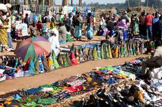 MALAWI: Colorful and ornate fabric for sale at the Malawi Market. Malawi, officially the Republic of Malawi, is a landlocked country in southeast Africa that was formerly known as Nyasaland. It is bordered by Zambia to the northwest, Tanzania to the northeast, and Mozambique on the east, south and west. The country is separated from Tanzania and Mozambique by Lake Malawi.