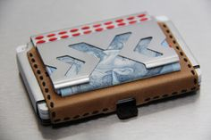 Paper money clip option. Holds up to five banknotes.