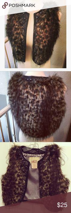"""BKE Faux Fur Animal Print Vest w/Studs & Beads M BKE Animal print Faux Fur Vest with studs & Beads on the Faux Leather black trim size M 🔥  EUC Bust 18"""" pit-to-pit  No closure  19"""" long at longest part   So cute ! BKE Jackets & Coats Vests"""