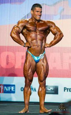 Bodybuilder blue posing trunks