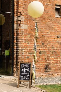 Shustoke-Farm-Barns-Wedding-balloons-and-chalkboard-welcome-sign