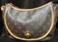 Louis Vuitton Brown Monogram Talum GM designer handbag. Pre-owned.     $800.50