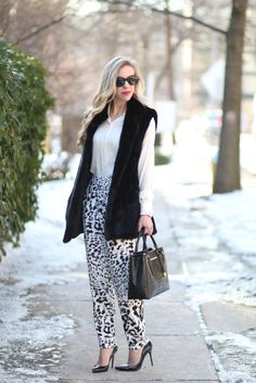 Winter Leopard: black long fur vest, animal print pants, snow leopard, leopard silk pants, fur vest worn over blouse, printed tapered ankle pants, Stuart Weitzman 'Nouveau' black patent pump, Brahmin 'Small Lincoln' satchel, snow leopard winter outfit