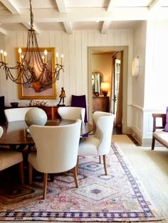 Ceiling, perfect wall colour, graceful dining chairs, beautiful midtones in wool rug layered over sisal