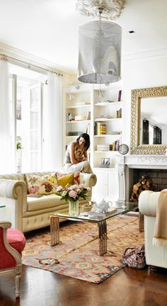 Eclectic but calm living room..LIKE THE RUG...the light fixture, not so much.