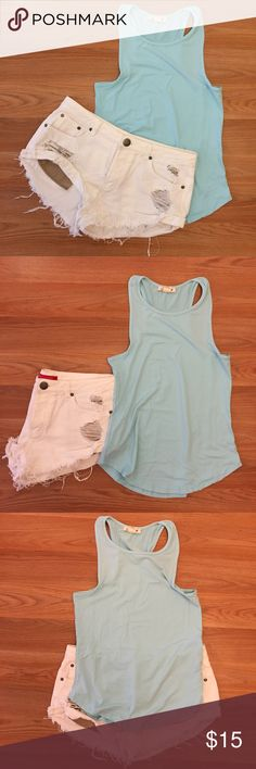Mint High Neck Racerback Tank Mint high neck, Racerback tank. Brand new. Never worn. 87% polyester 13% spandex. Available in S-L. No Paypal. No trades. 15% discount on all 3+ item bundles made with the bundle feature. No offers will be considered unless you use the make me an offer feature.    👉 Please follow 📱 Instagram: BossyJoc3y 👠 Blog: www.bossyjocey.com Tops Tank Tops